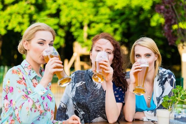 Friends drinking in beer garden restaurant