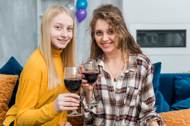 Friends drinking a cup of wine