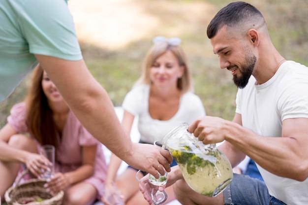 Friends drinking lemonade together