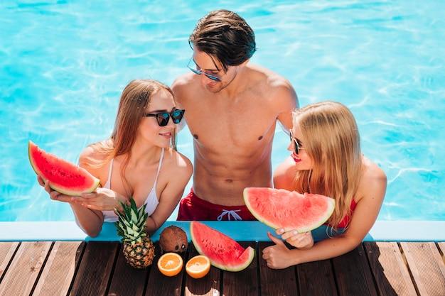 Friends enjoying a fresh watermelon