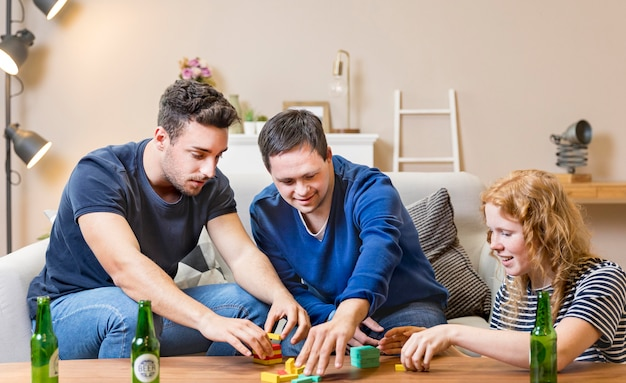 Friends enjoying playing games and having beer