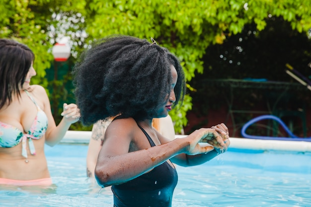 Friends enjoying the swimming pool