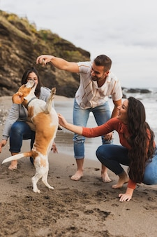 Friends enjoying time with dog