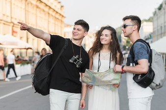 Friends exploring city with map