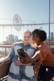 Friends gathering on bridge medium shot