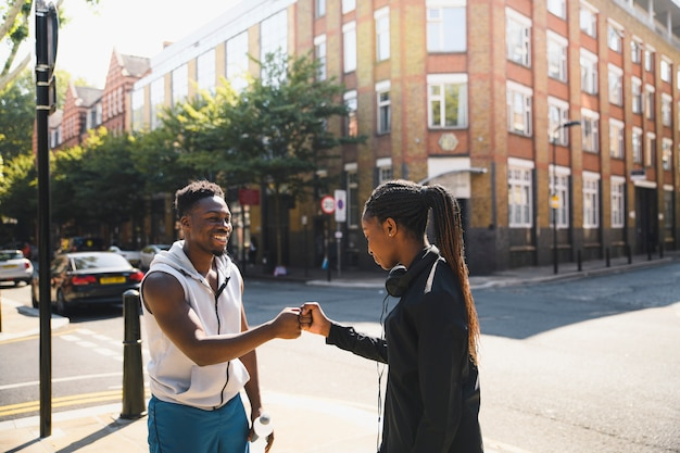 Friends giving a fist bump in london
