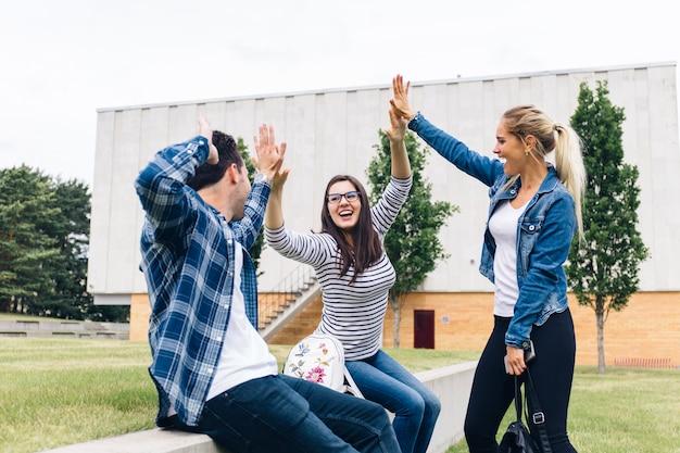 Friends giving high five