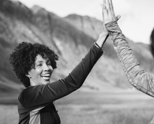 Friends giving a high five