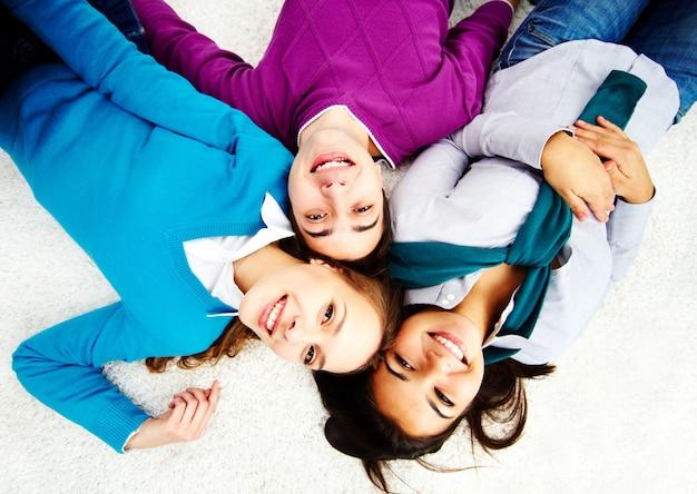 Friends having fun on the floor