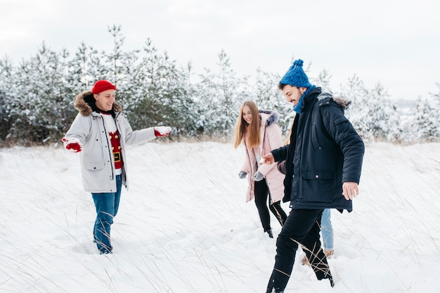 Friends having fun in winter forest