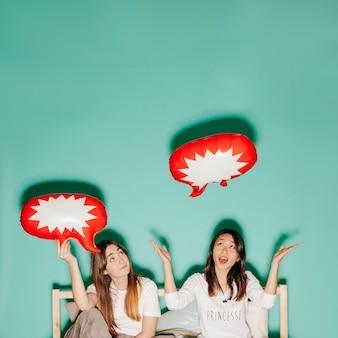 Friends having fun with speech balloons