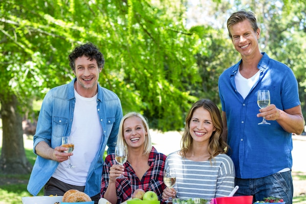Friends having a picnic with wine