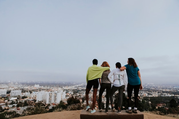 Friends hiking through the hills of los angeles