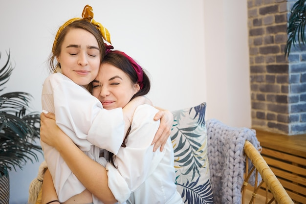 Friends hugging at home