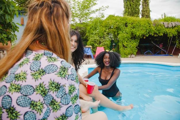 Friends joking at swimming pool