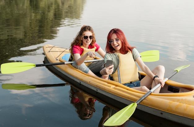 Friends in kayak taking selfie