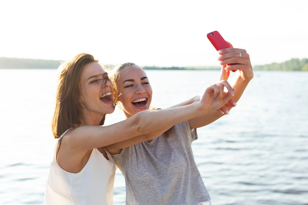 Friends laughing while taking a selfie