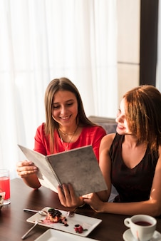 Friends looking at a menu