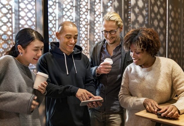 Friends looking at a smartphone
