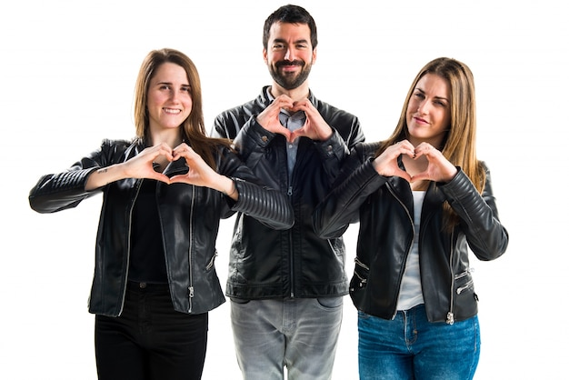Friends making a heart with their hands