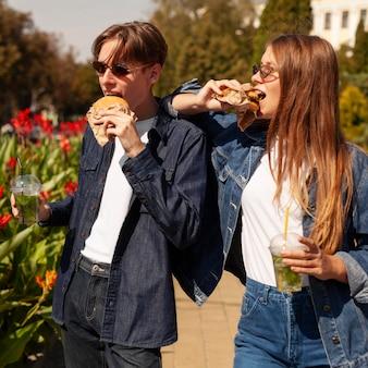 Friends outdoors enjoying burgers
