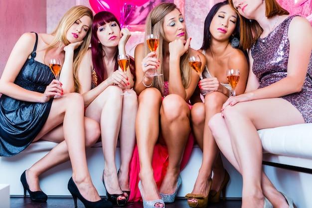 Friends partying in night club until sleep