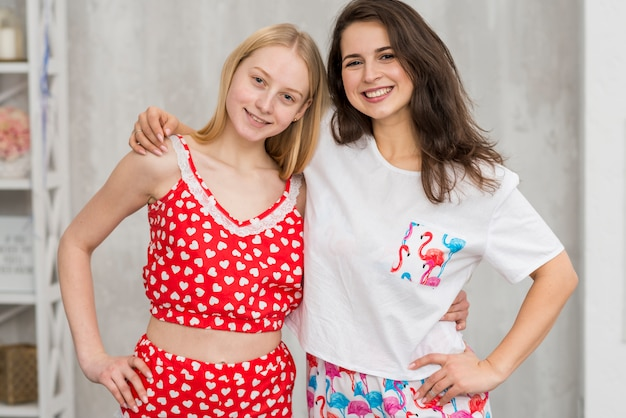 Friends in pijama party posing for a picture