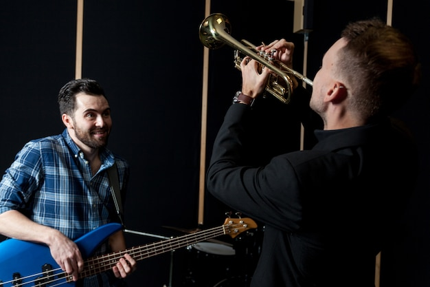 Friends playing guitar and trumpet