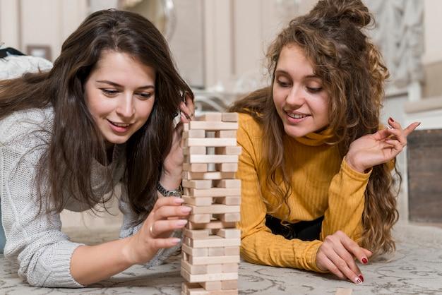 Friends playing jenga
