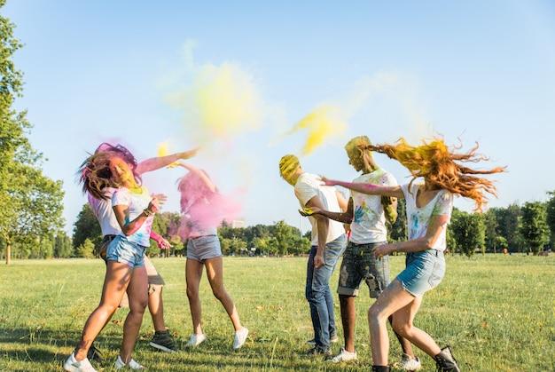 Friends playing with holi powder