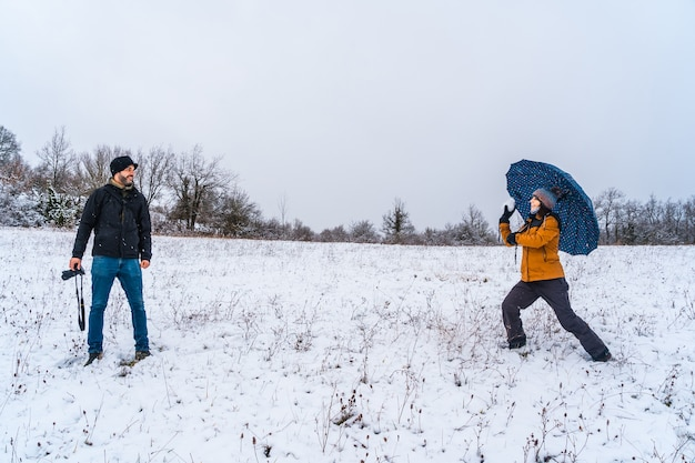 Friends playing with snowballs in the snow snow in the town of opakua near vitoria