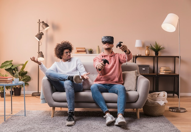 Friends playing with virtual headset