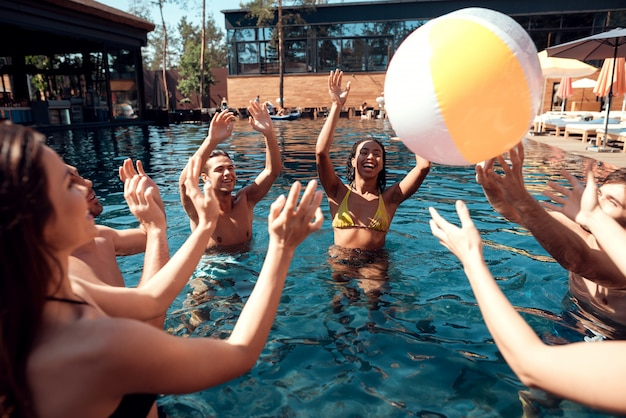 Friends at pool party. summer vacation concept