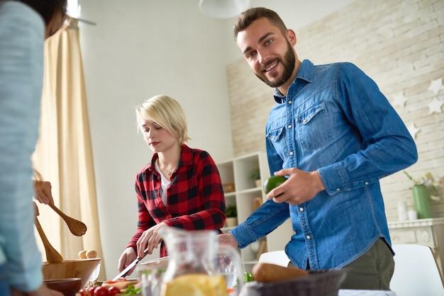 Friends preparing dinner together