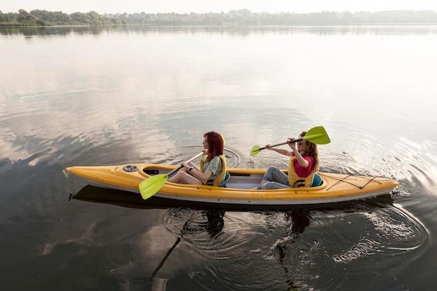 Friends rowing in kayak