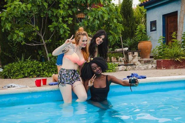 Friends selfie in the swimming pool