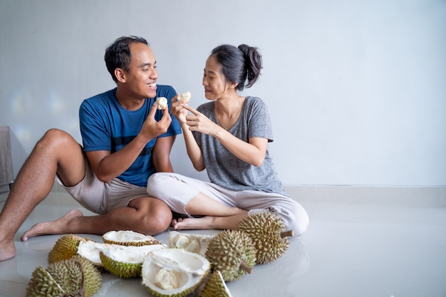 Friends sharing and eat durian fruits