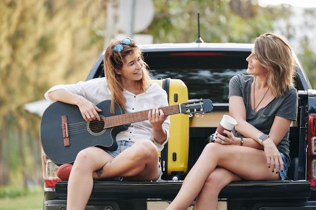 Friends singing in pickup truck