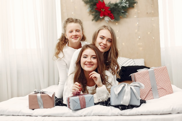 Friends spent time at home. two girls with christmas gift. sisters together.