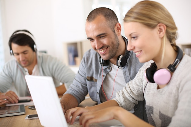 Friends in student lounge websurfing on internet