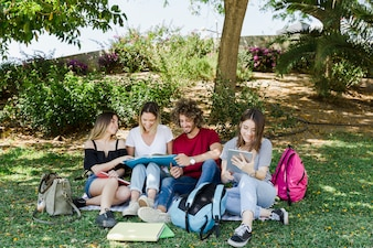 Friends studying in green park