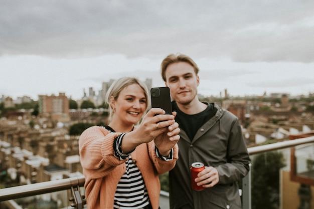 Friends taking a group selfie