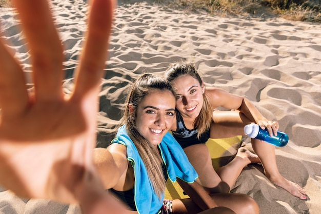 Friends taking a selfie on fitness mat