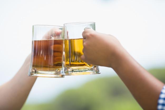 Friends toasting beer glasses