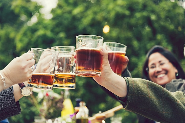 Friends toasting at a garden party