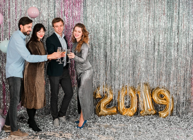 Friends toasting new year party