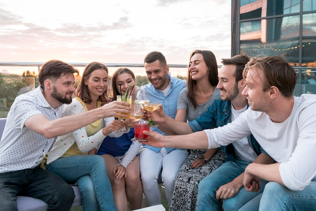 Friends toasting at a terrace party