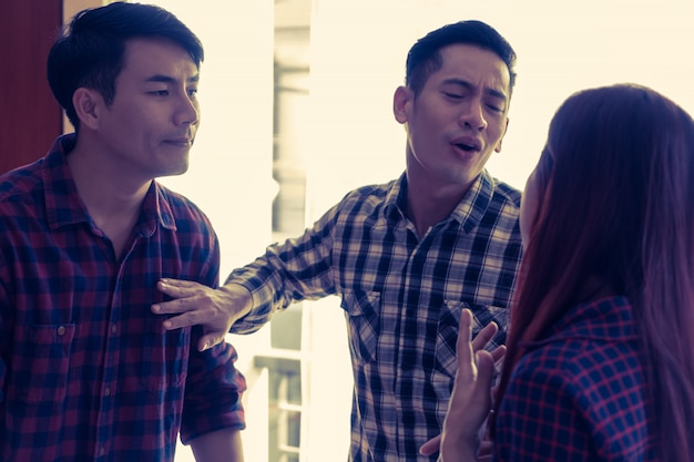 Friends trying to stop work couple from fighting each other