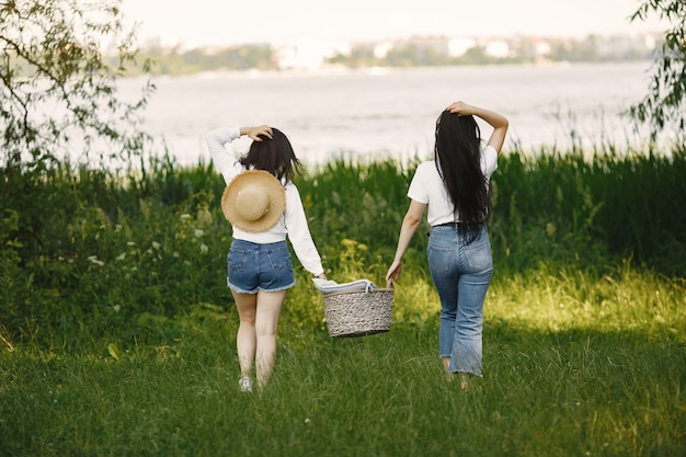 Friends walks. girls with a basket. woman in a white shirt.