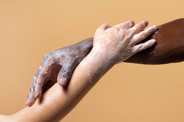 Friends washing hands with soap